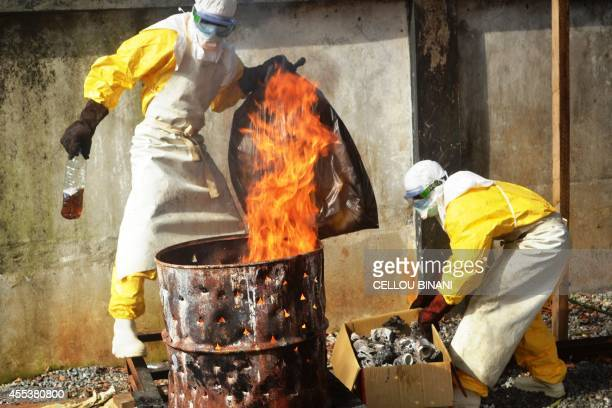 Health worker burn used protection gear at the NGO Medecins Sans Frontieres center in Conakry on September 13 2014 For nearly four decades mention of...