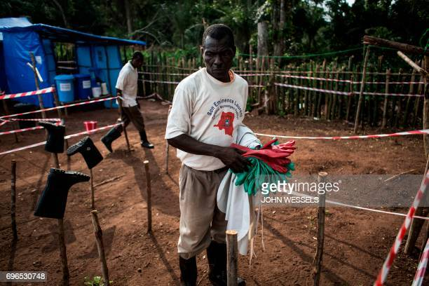 A health worker cleans equipment at an Ebola quarantine unit on June 11 2017 in Muma after a case of Ebola was confirmed in the village Two cases of...