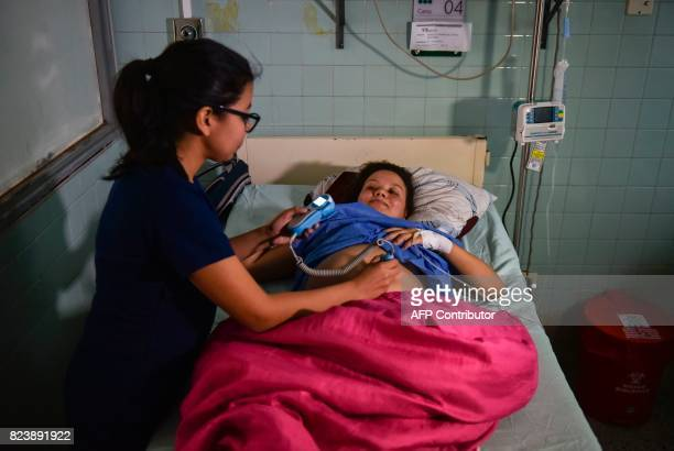 A health worker monitors Venezuelan national Joselis Canas as she waits for her due date at the Erasmo Meoz University Hospital in Cucuta North of...