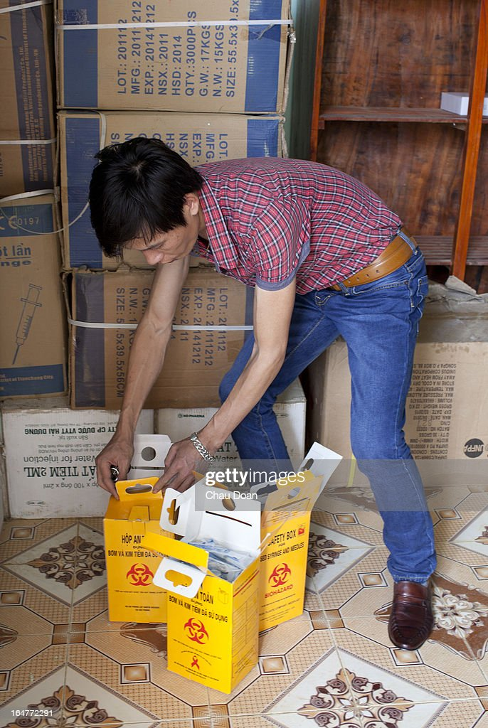 A health worker packs up boxes of used syringes and needles, returned by drug addicts, are prepared for safe destruction at the center for health counseling and voluntary HIV testing, at the Muong Ang Health Center. Drug addicts can pick up clean, new syringes and needles from the center..