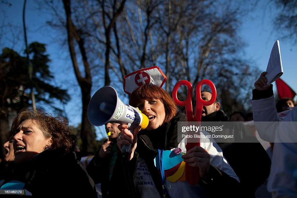 A health worker shouts slogans during a march by thousands of people on February 23, 2013 in Madrid, Spain. Public health workers, civil servants and disaffected citizens converged on central Madrid to protest against the austerity measures of Prime Minister Mariano Rajoy.