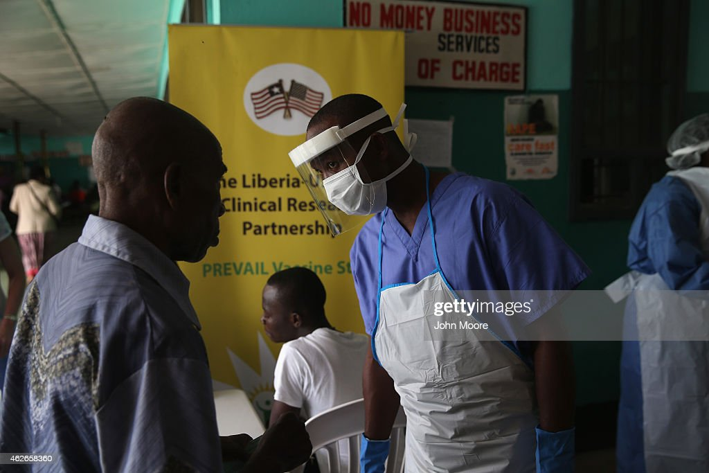 A health worker speaks with a participant in the Ebola vaccine trials which were launched at Redemption Hospital formerly an Ebola holding center on...
