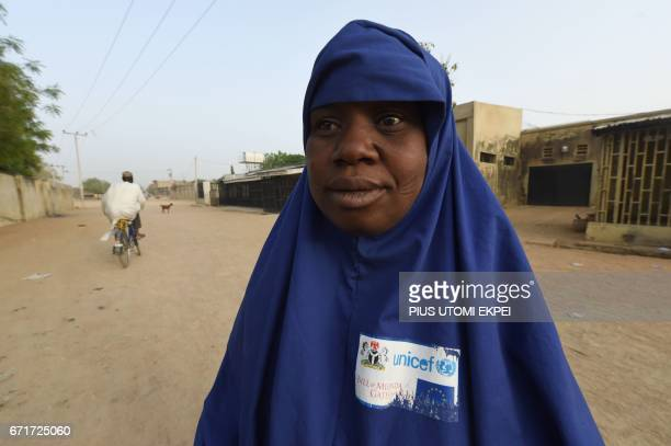 A health worker stands in the street during a vaccination campaign against polio at HotoroKudu Nassarawa district of Kano in northwest Nigeria on...