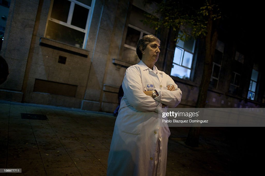 A health worker stands outside La Princesa Hospital during a protest on November 26, 2012 in Madrid, Spain. Trade unions for the first time have called for a 48 hour health worker's general strike in the Madrid Region after Regional Government announced severe cuts and privatization of Medical Centers.