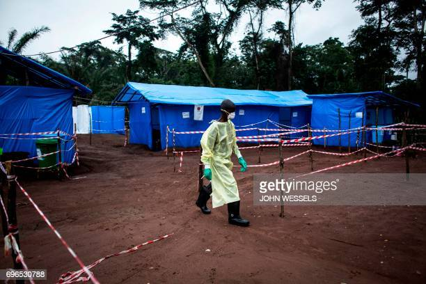 TOPSHOT A health worker walks at an Ebola quarantine unit on June 13 2017 in Muma after a case of Ebola was confirmed in the village Two cases of the...