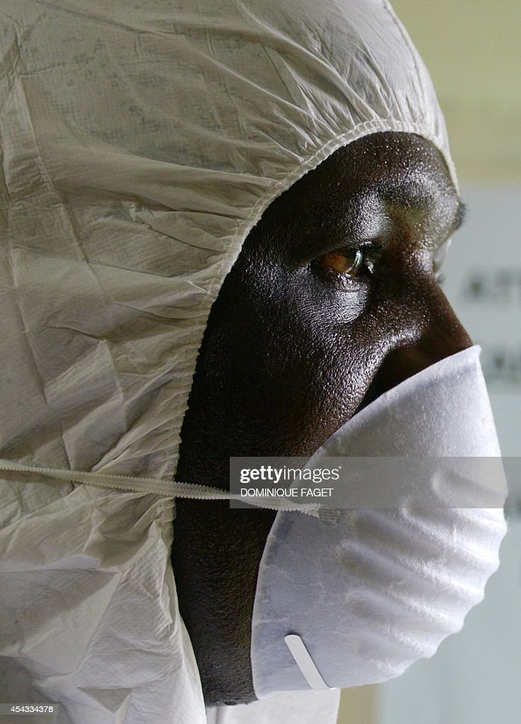 A health worker, wearing a protective suit, conducts an ebola prevention drill at the port in Monrovia on August 29, 2014. The World Health Organization said yesterday that the number of Ebola cases was increasing rapidly and could exceed 20,000 before the virus is brought under control, as the death toll topped 1,500.