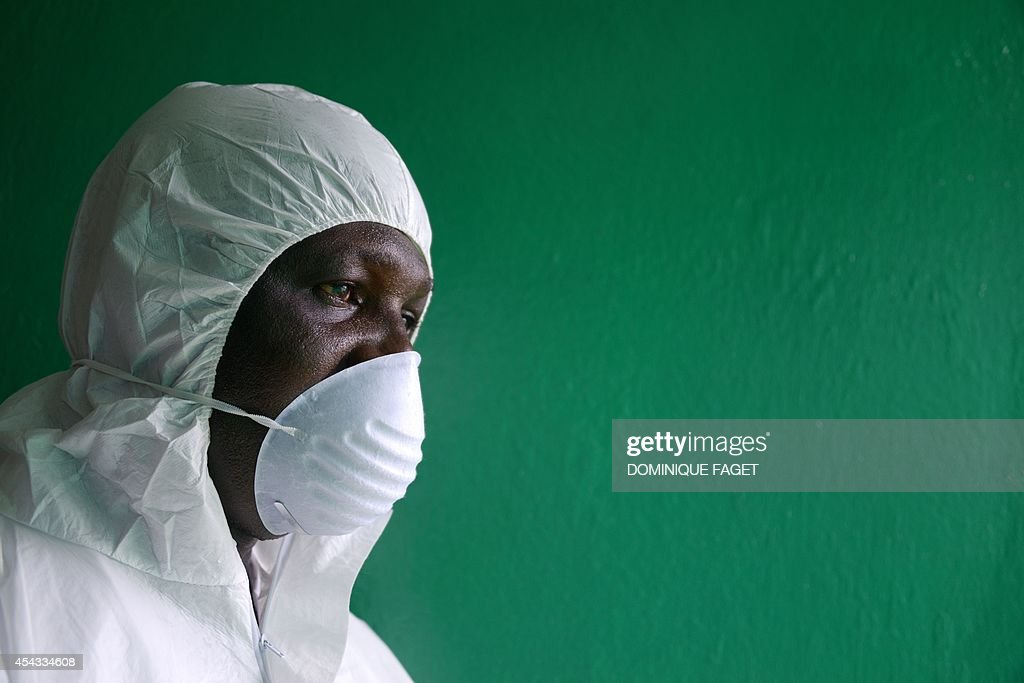 A health worker, wearing a protective suit, conducts an ebola prevention drill at the port in Monrovia on August 29, 2014. The World Health Organization said yesterday that the number of Ebola cases was increasing rapidly and could exceed 20,000 before the virus is brought under control, as the death toll topped 1,500. AFP PHOTO/DOMINIQUE FAGET