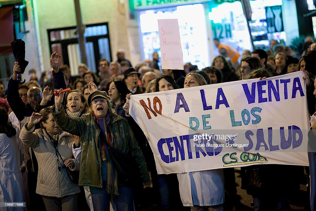 Health workers and supporters protest outside La Princesa Hospital on November 26, 2012 in Madrid, Spain. Banner reads 'Do not sell the Health Service Centers'. Trade unions for the first time have called for a 48 hour health worker's general strike in the Madrid Region after Regional Government announced severe cuts and privatization of Medical Centers.