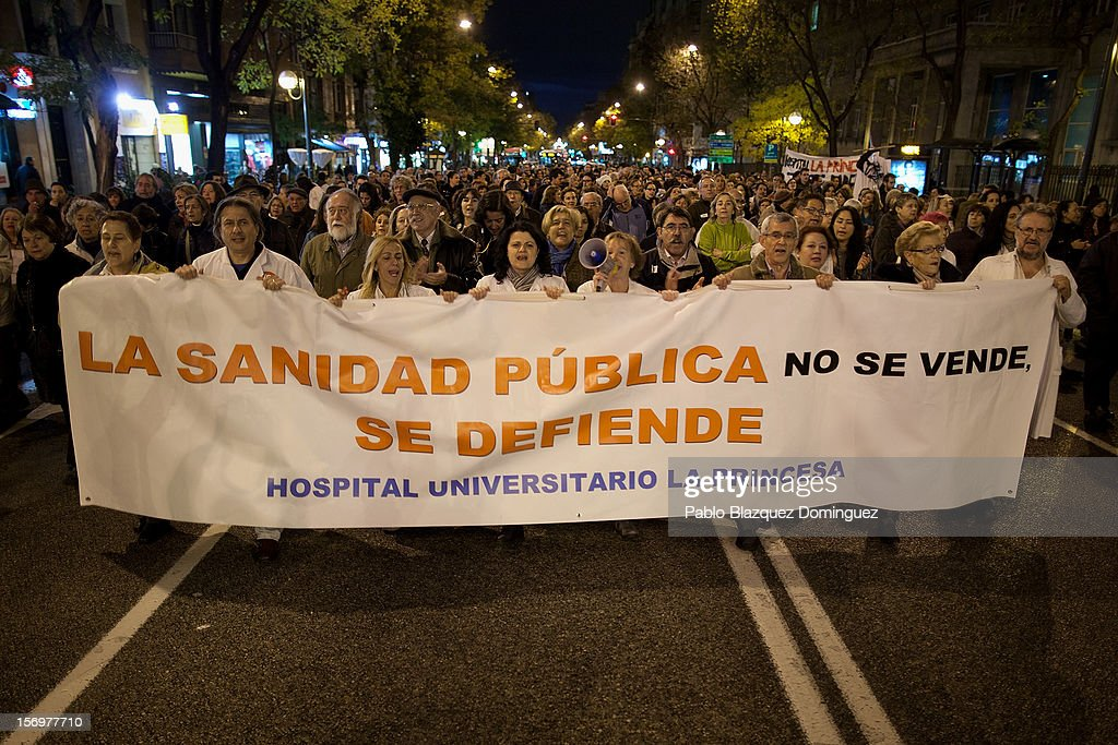 Health workers and supporters protest with a banner that reads 'Health Services are not for sale, but to be defended' outside La Princesa Hospital on November 26, 2012 in Madrid, Spain. Trade unions for the first time have called for a 48 hour health worker's general strike in the Madrid Region after Regional Government announced severe cuts and privatization of Medical Centers.