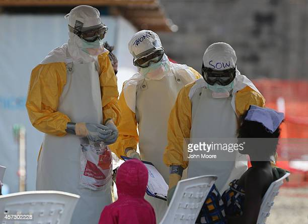 Health workers at Doctors Without Borders talk with Ebola patients in the highrisk area of the ELWA 3 Ebola treatment center on October 16 2014 in...