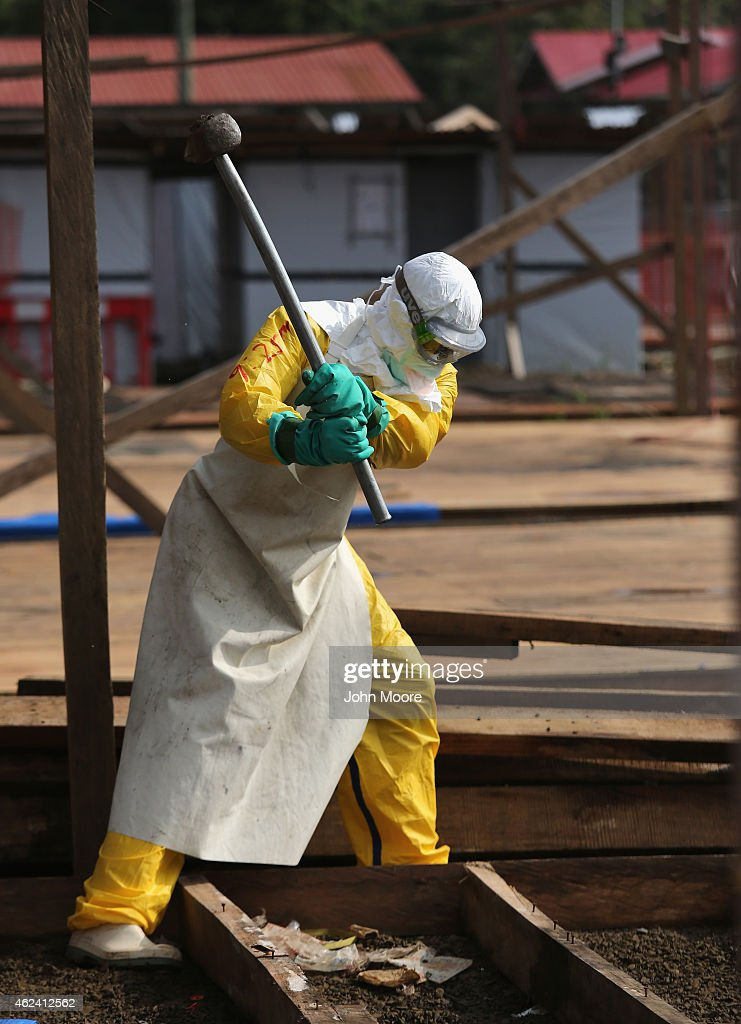 Health workers from Doctors Without Borders dismantle a section of their main Ebola Treatment Unit on January 26 2015 in Paynesville Liberia MSF...