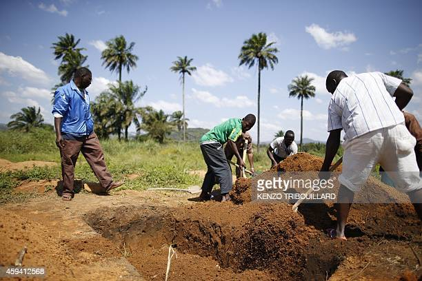 Health workers from Guinea's Red cross wearing Personal Protective Equipments prepare to bury bodies of victims of the Ebola virus in Macenta in...