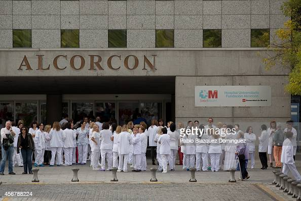 Health workers gather in a protest outside Hospital Fundacion Alcorcon where a Spanish nurse tested positive for the Ebola virus on October 7 2014 in...