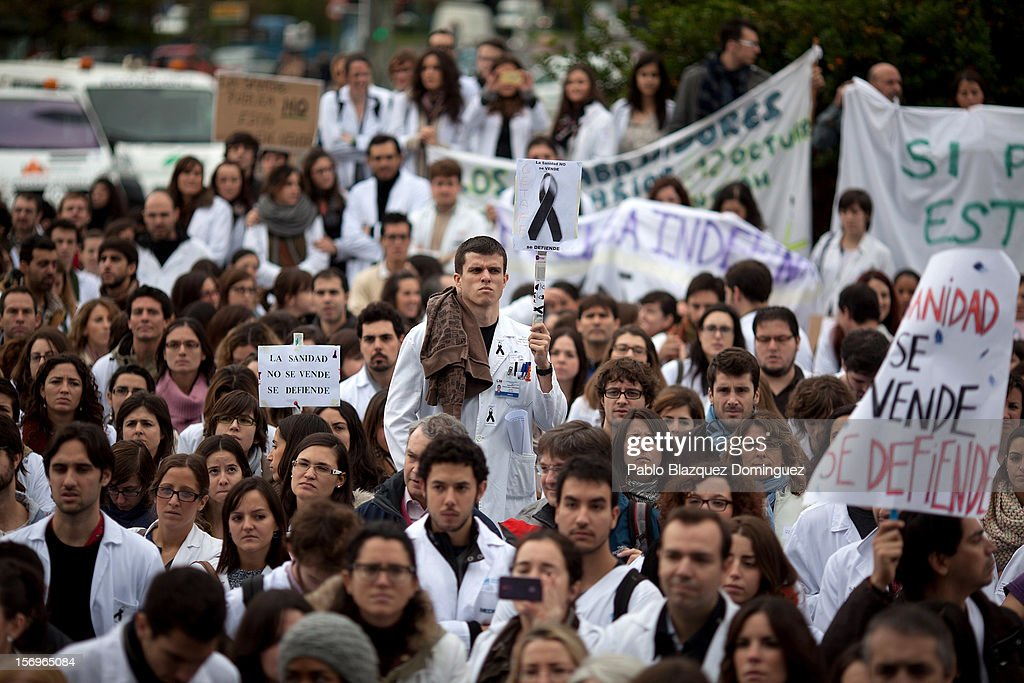 Health workers gather to protest outside La Paz Hospital on November 26, 2012 in Madrid, Spain. Trade unions for the first time have called for a 48 hour health worker's general strike in the Madrid Region after Regional Government announced severe cuts and privatization of Medical Centers.