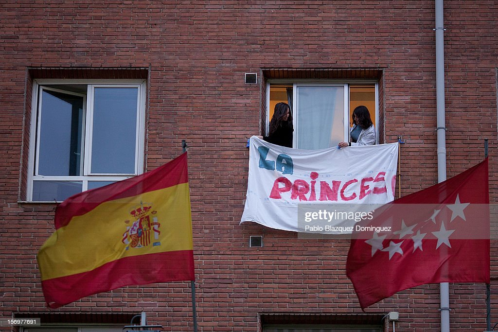 Health workers hang a banner that reads 'La Princesa' behind Spanish National flag and Madrid Regional flag at La Princesa Hospital on November 26, 2012 in Madrid, Spain. Trade unions for the first time have called for a 48 hour health worker's general strike in the Madrid Region after Regional Government announced severe cuts and privatization of Medical Centers.