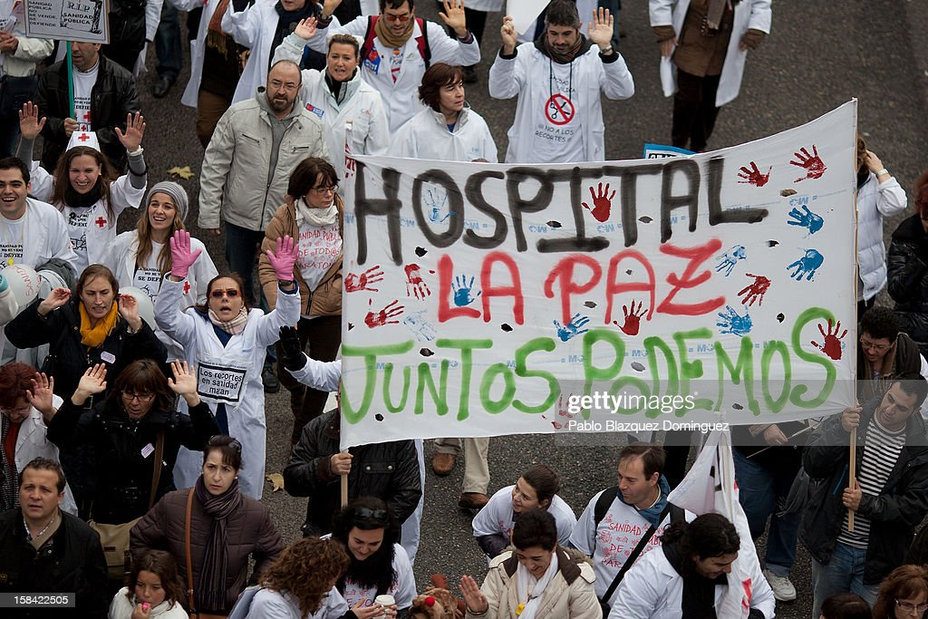 Health workers hold a banner reading 'La Paz Hospital. Together we can' during a demonstration against cuts on public health care and the privatization of medical centers and hospitals on December 16, 2012 in Madrid, Spain. In Madrid, doctors have already staged 11 days of strikes and all health workers unions are calling for a third 48 hour strike on December 19 and December 20. Around 4,000 operations have been suspended in Madrid since the medical strikes started.