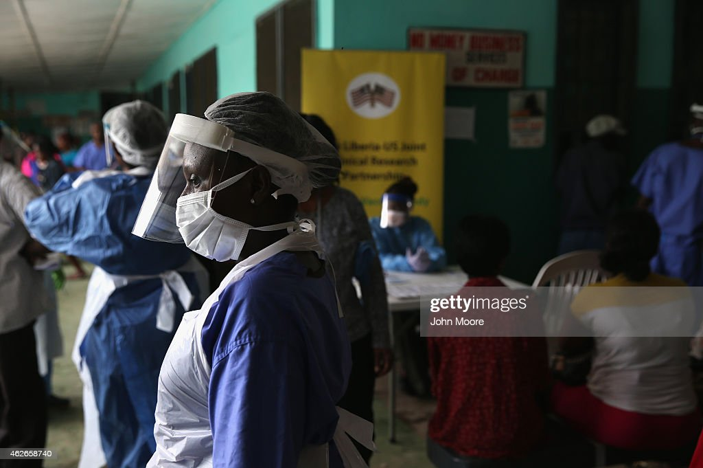 Health workers in protective clothing await patients in the outpatient lounge of Redemption Hospital formerly an Ebola holding center on February 2...