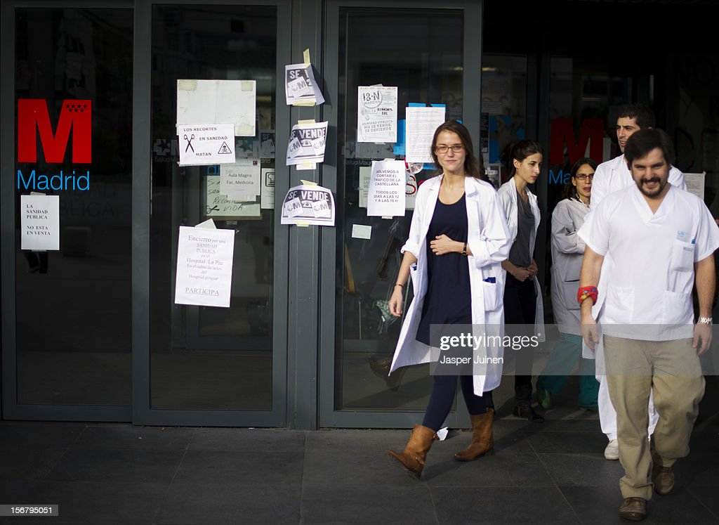 Health Workers leave La Paz hospital on November 21, 2012 in Madrid, Spain. Doctors and nurses in the Spanish capital are preparing for a four day strike to protest against the privatisation of some parts of Spain's national health service.