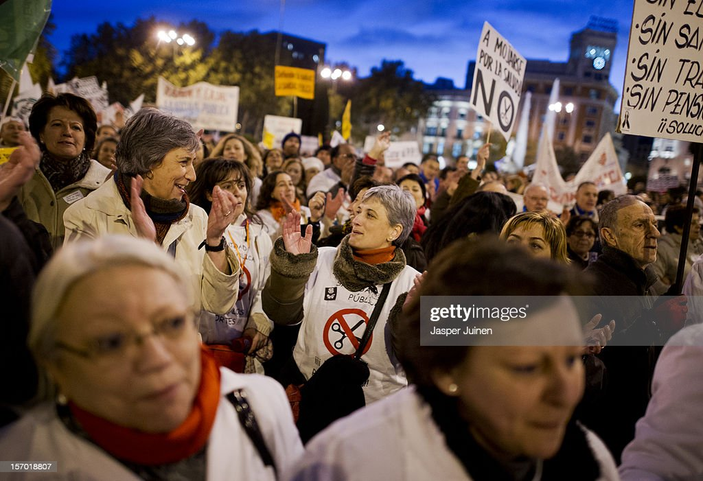 Health workers shout during a demonstration held on the second day of a two day general strike on November 27, 2012 in Madrid, Spain. For the first time, all trade unions have called for a 48 hours general strike for the health workers in the Madrid region to protest against the privatisation of some parts of Spain's national health service.