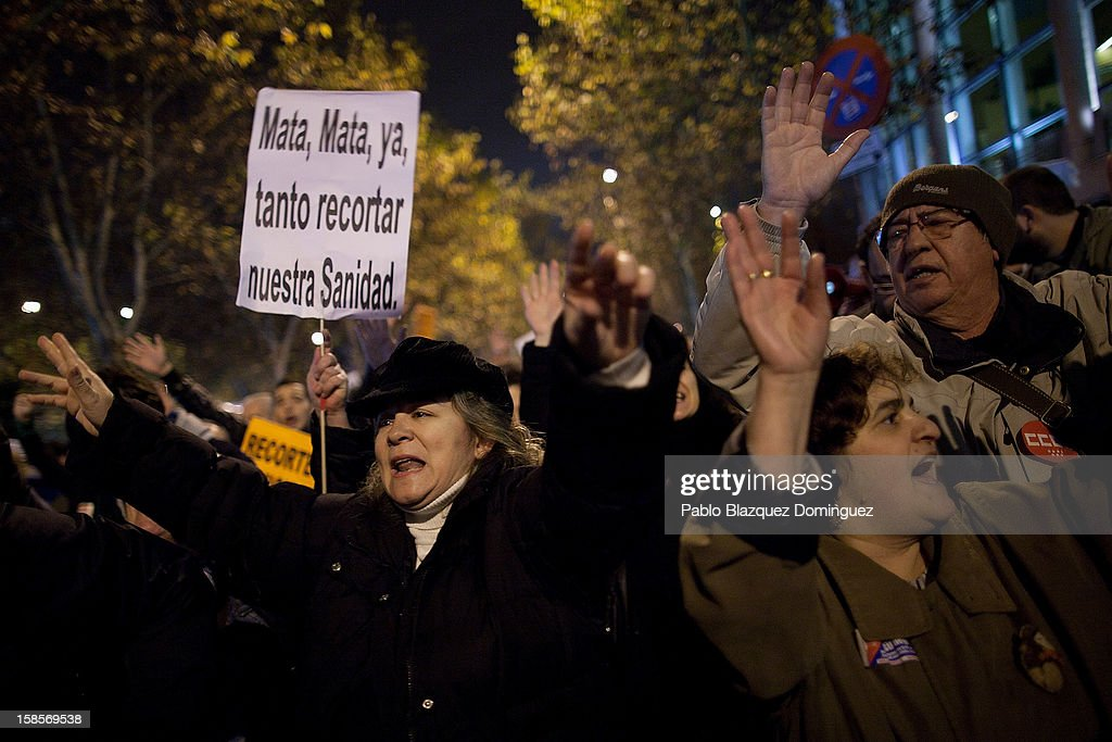 Health workers shouts slogans during a demonstration outside Madrid Regional Asembly on December 19, 2012 in Madrid, Spain. As of today, health workers unions are calling for a third 48-hour strike against cuts on public health care and the privatization of medical centers and hospitals.