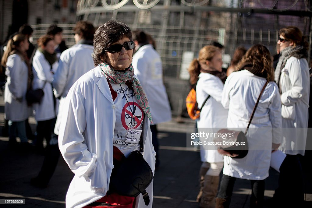 Health workers take part in a demonstration at Puerta del Sol Square on December 4, 2012 in Madrid, Spain. All trade unions called for the second 48 hours health workers' general strike in Madrid region, after Regional Government announced severe cuts and privatization of Medical Centers.