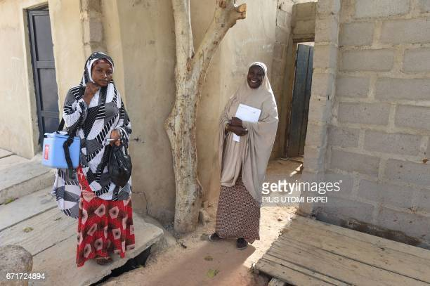 Health workers walk from house to house in search of children to immunise during a vaccination campaign against polio at HotoroKudu Nassarawa...