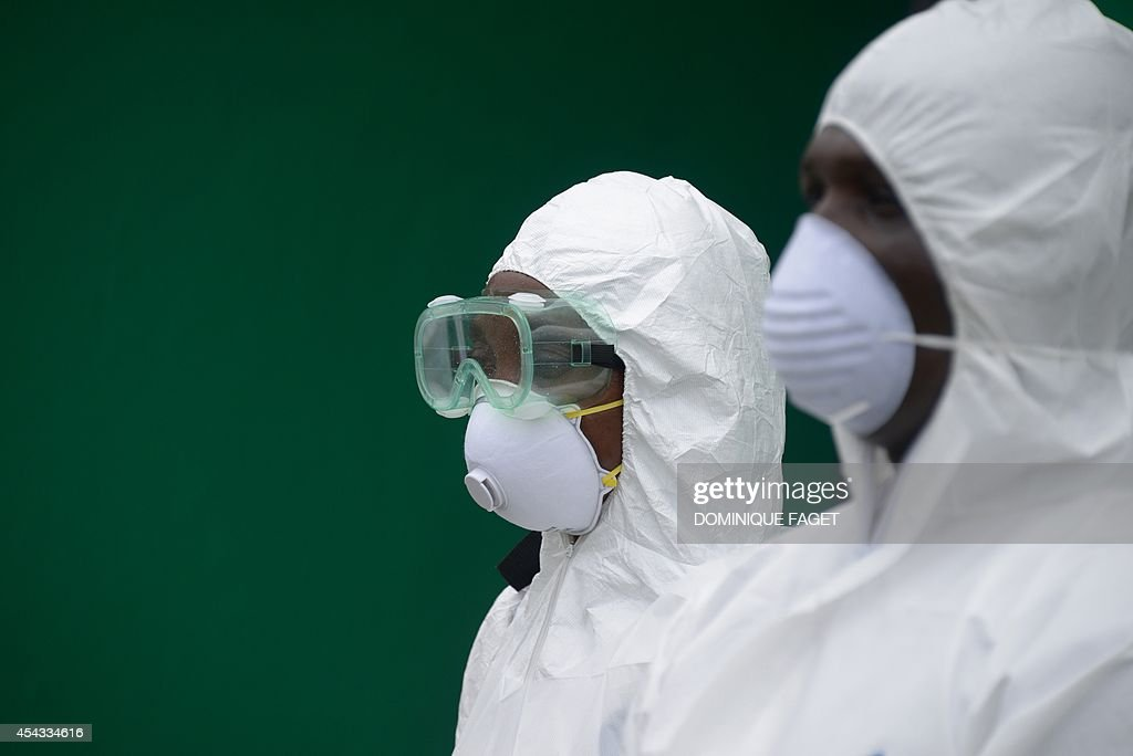 Health workers, wearing a protective suit, conduct an ebola prevention drill at the port in Monrovia on August 29, 2014. The World Health Organization said yesterday that the number of Ebola cases was increasing rapidly and could exceed 20,000 before the virus is brought under control, as the death toll topped 1,500.