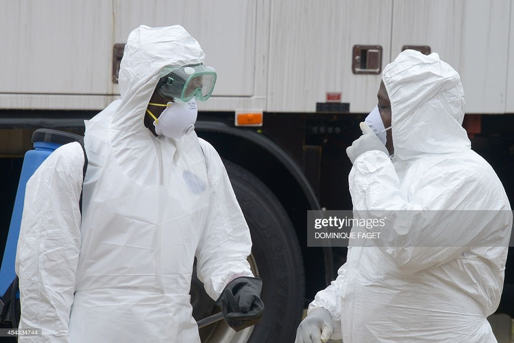 Health workers, wearing protective suits, conduct an ebola prevention drill at the port in Monrovia on August 29, 2014. The World Health Organization said yesterday that the number of Ebola cases was increasing rapidly and could exceed 20,000 before the virus is brought under control, as the death toll topped 1,500.
