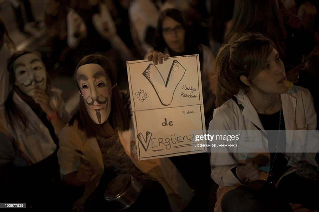 Health workers wearing white coats and Guy Fawkes masks take part in a protest to denounce budget cuts and privatisations in health services, in Malaga of November 26, 2012. The health sector has been hard hit by the austerity policies implemented by the rightwing government of Mariano Rajoy, which is trying to cut the public deficit in the eurozone's fourth largest economy. The CESM medical union announced a strike for today and November 27 to be repeated on December 4 and 5. AFP PHOTO / JORGE GUERRERO