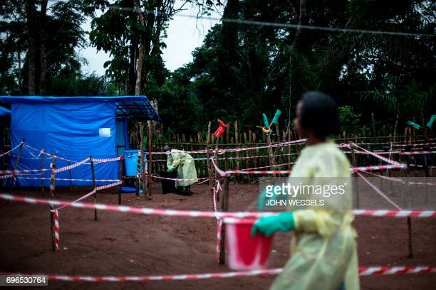 Health workers work at an Ebola quarantine unit on June 13 2017 in Muma after a one case of Ebola was confirmed in their village Two cases of the...