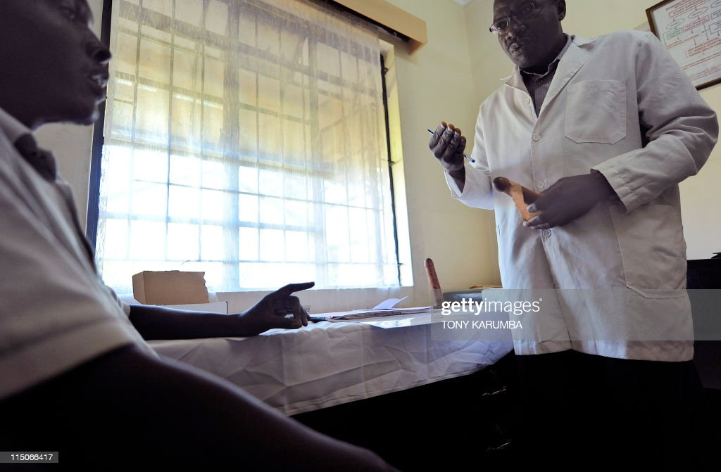 Health-AIDS-anniversary-Kenya, By Francois Ausseil Photo made May 31, 2011 shows a man during a counselling session before undergoing circumcission at a donor-funded clinic in Kenya's lake-side town of Kisumu. Started in year-2000 as a study carried out jointly by the Universities of Nairobi in Kenya, Illinois in the US and Manitoba in Canada, collectively known as UNIM, it looked at the impact of circumcision on the prevention of HIV/AIDS, the results of which met the approval of the World Health Organisation, WHO, and resulted in Kenyan authorities putting in place a vast free circumcision programme at the end of 2008. Nyanza county in Kenya, where the UNIM initiative is based, indegenes of which are traditionally the Luo community who practice non-circumcision was targetted by the study owing a significantly high incidence of HIV/AIDS, that studies prior to UNIM had noted was far greater than in immediate neighbouring communities that traditionally practiced circumcision. AFP PHOTO/Tony KARUMBA