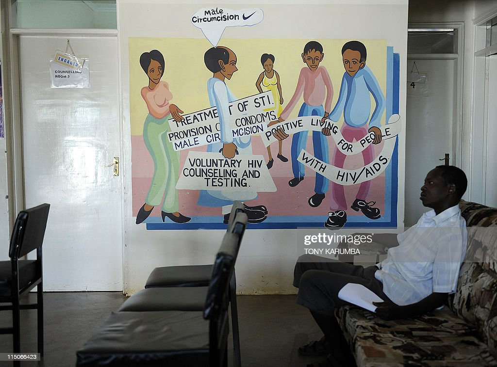 Health-AIDS-anniversary-Kenya, By Francois Ausseil Photo made May 31, 2011 shows a man sitting infront of a mural promoting the benefits of circumcision against HIV/AIDS as he waits to be counselled at a donor-funded clinic in Kenya's lake-side town of Kisumu that performs free HIV counselling and circumcision. Started in year-2000 as a study carried out jointly by the Universities of Nairobi in Kenya, Illinois in the US and Manitoba in Canada, collectively known as UNIM, it looked at the impact of circumcision on the prevention of HIV/AIDS, the results of which met the approval of the World Health Organisation, WHO, and resulted in Kenyan authorities putting in place a vast free circumcision programme at the end of 2008. Nyanza county in Kenya, where the UNIM initiative is based, indegenes of which are traditionally the Luo community who practice non-circumcision was targetted by the study owing a significantly high incidence of HIV/AIDS, that studies prior to UNIM had noted was far greater than in immediate neighbouring communities that traditionally practiced circumcision. AFP PHOTO/Tony KARUMBA