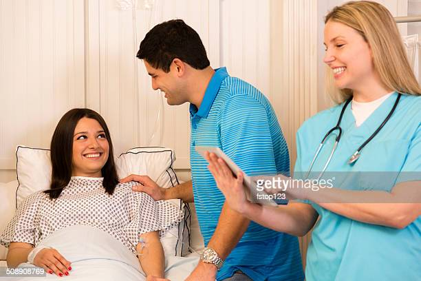 Healthcare: Husband visits wife in hospital. Doctor checks on patient.