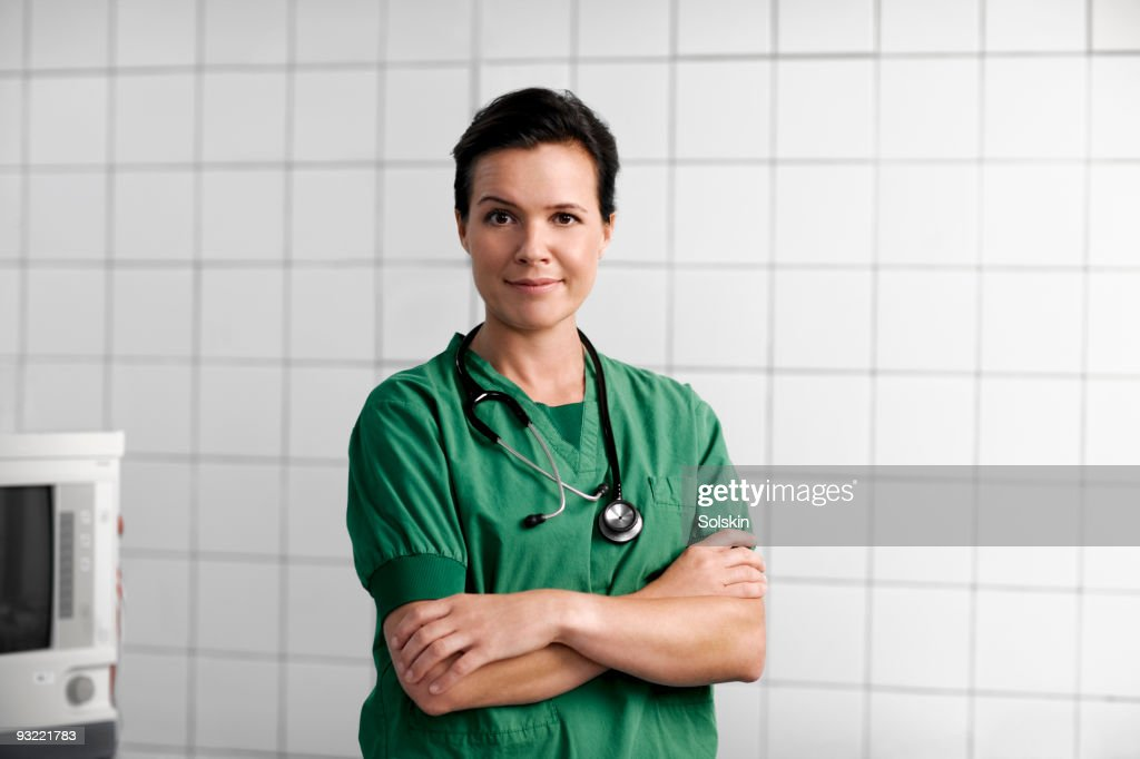 Healthcare professional standing in surgery room : Stock Photo