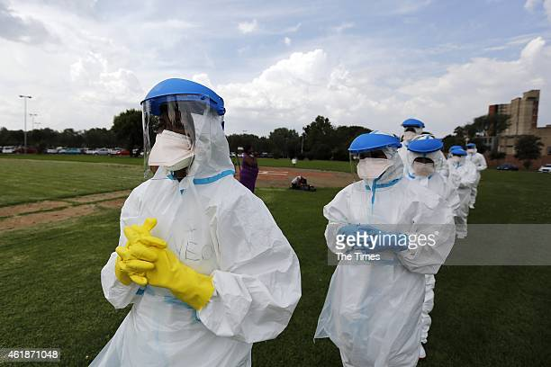 Healthcare professionals who have been recruited to work in Sierra Leone as part of the Ebola Emergency Response initiative take part in a practice...