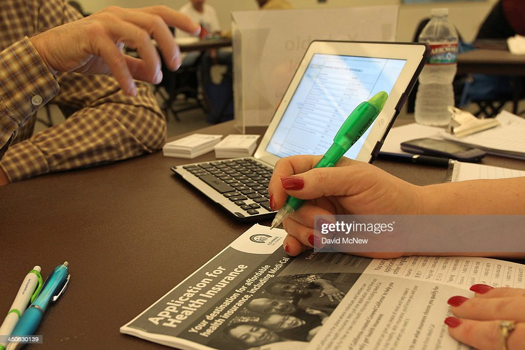 A healthcare reform specialist helps people select insurance plans at the free Affordable Care Act Enrollment Fair at Pasadena City College on...