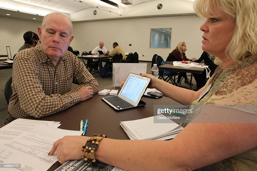 Healthcare reform specialist Stacy Chagolla helps William Bishop compare plans at the free Affordable Care Act Enrollment Fair at Pasadena City...