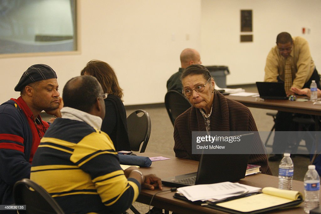 Healthcare reform specialists help people select insurance plans at the free Affordable Care Act Enrollment Fair at Pasadena City College on November...