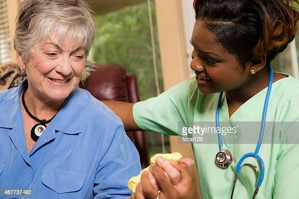 Healthcare: Senior adult woman does hand therapy with putty.