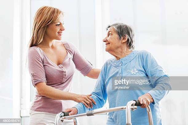 Healthcare worker communicating with a senior patient.