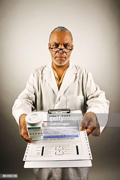 Healthcare worker holding drug test