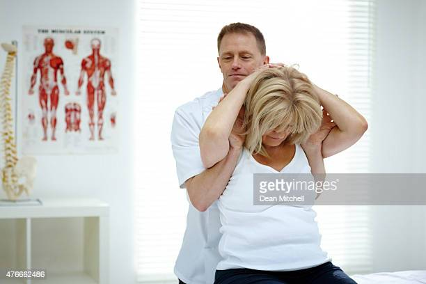 Healthcare worker treating senior woman