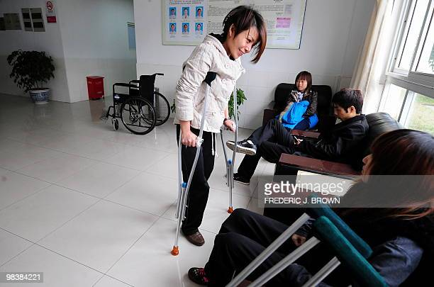 STORY 'HealthChinalifestyleFEATURE' by Pascal Trouillaud A woman on crutches chats with another patient seated comparing experiences after having...