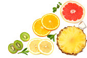 healthy background. slices of grapefruit, kiwi fruit, orange and pineapple isolated on white background top view