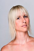 Healthy beautiful blonde woman face shot on white background