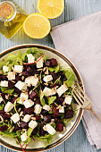 Healthy beetroot salad with feta cheese, arugula and sunflower seeds.