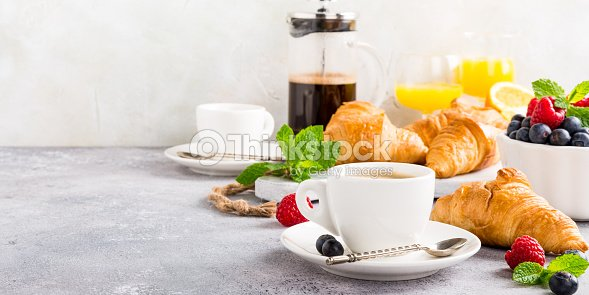 Healthy breakfast with coffee and croissants : Stock Photo