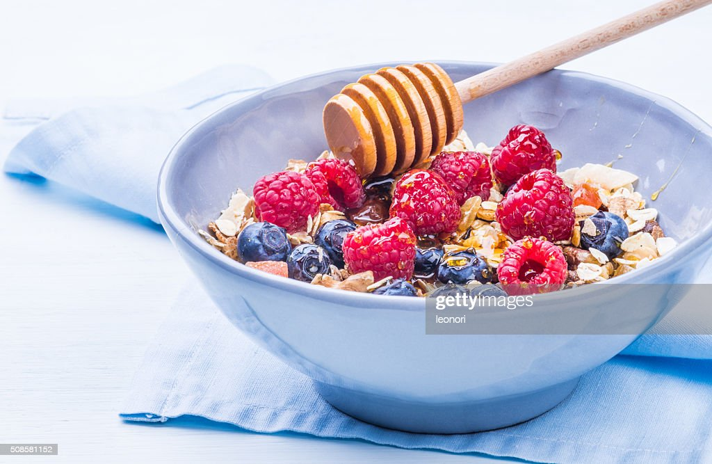 Healthy breakfast with muesli and berries. : Stock Photo