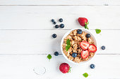healthy breakfast with muesli and berries, top view, flat lay