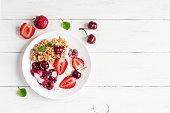 healthy breakfast with yogurt, muesli and berries, top view, flat lay